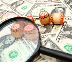 Magnifier and lotto on banknotes (dollars).
