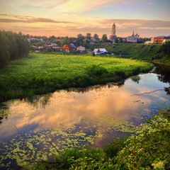 Ancient Russian town of Suzdal and Kanenka river on sunset.