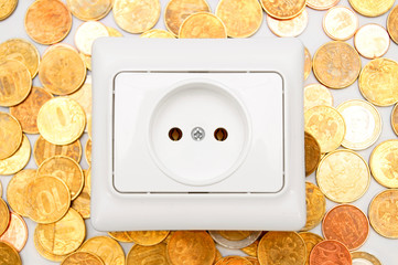 Electric socket on gold coins.