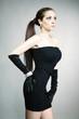 Brunette beauty posing in black apparel