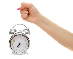 Alarm clocks and female fist. On a white background.
