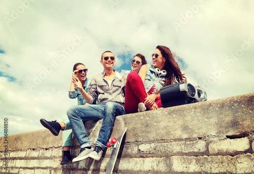 group of smiling teenagers hanging out