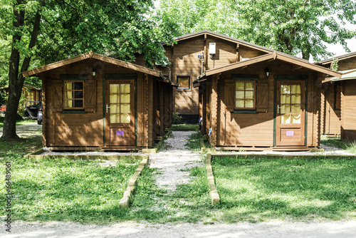 Foto op Canvas Kamperen Wooden bungalows on campsite camping