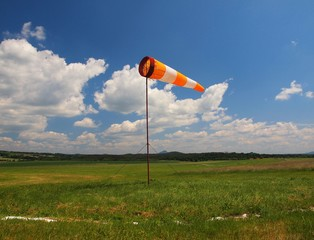 Summer hot day on sport airport with Abandoned  windsoc, wind