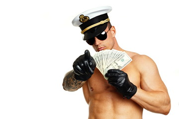 Man in captain cap with sunglasses shows you money