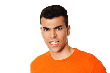 Crazy young man at orange shirt showing teeth