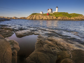 The Nuble lighthouse at sunset in York, Maine