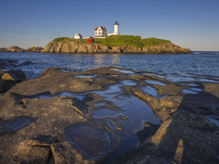 The Nubble lighthouse at sunset in York, Maine