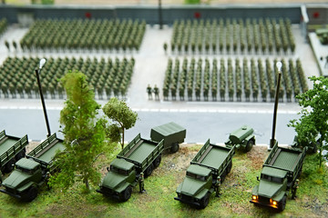 Miniature of soldiers in ranks and fighting machines