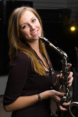 Pretty woman with saxophone