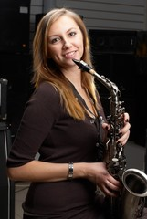 Pretty woman with saxophone