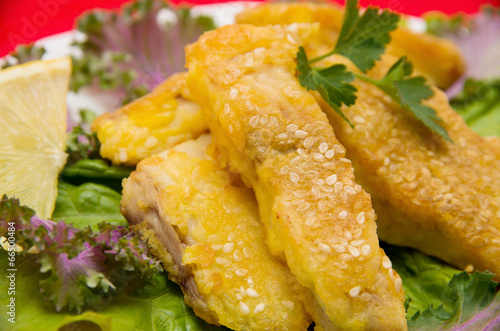 Fototapeta Delicious spiced catfish