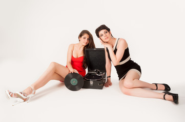 Pretty women with gramophone
