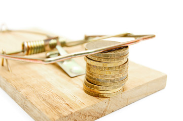 Gold coins in a mousetrap. On a white background.