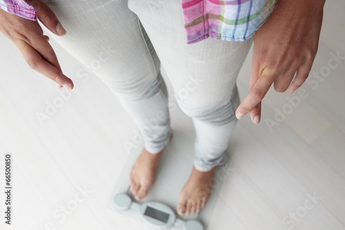 canvas print picture Close up detail girl weighing herself