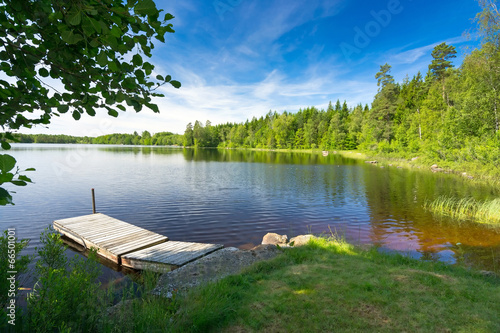 Tuinposter Scandinavië Summer Swedish lake in morning light