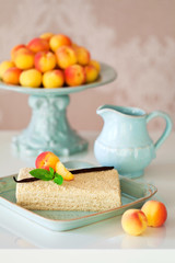 Cake with cream and fresh apricots, selective focus