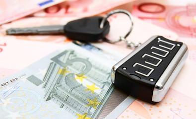 Keys from car on money.