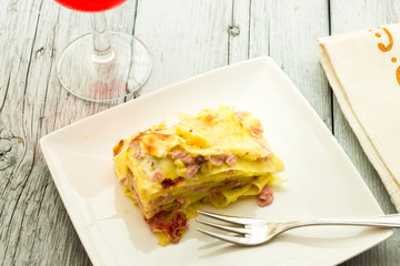 Lasagna with ham and pistachios