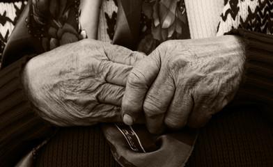 Macro image hands of senior woman