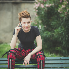 young lesbian stylish hair style woman using smart phone