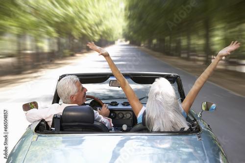 Senior couple in sports car - 66504857