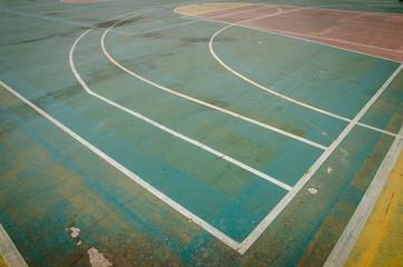 old outdoor basketball court floor