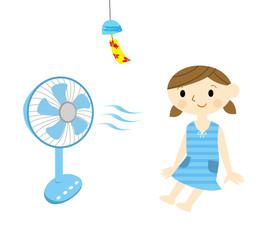 扇風機にあたる子供