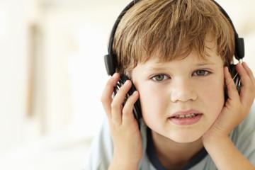 Young boy wearing headphones