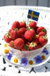 Sweet strawberries for Midsummer with Swedish flag on the top