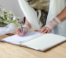 Wedding signature: Bride signing marriage license
