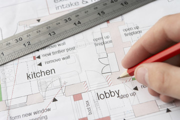 Man working on technical drawing