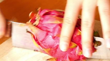 Cutting Fresh Dragon Fruit or Pitahaya on the Plank. Tropical