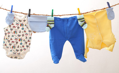 Baby clothes drying on rope. Kids underwear on white backgroud