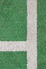 green artifical grass and white strip line