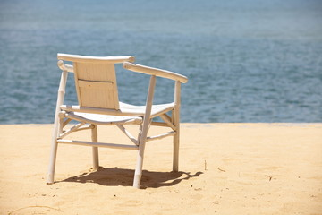 White wood beach chair on nice sand beach