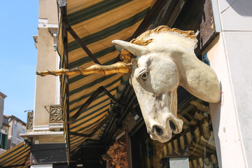 Unicorn head on the facade of a building in Venice, Italy