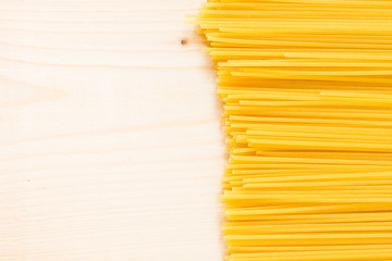 spaghetti on a wood background - top view