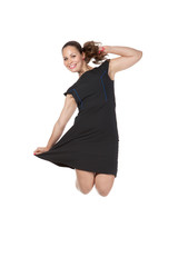 girl in a dress jumping in studio