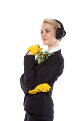 stewardess with headphones listening to music