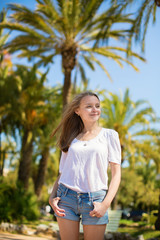 Young beautiful girl enjoying sunny day in Cannes