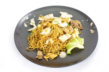 Chinese food stir - fried noodles with pork and vegetables