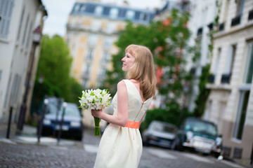 Beautiful bride on a street ofMontmartre in Paris