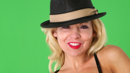 Portrait of alluring sexy blond woman with hat