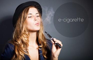 Woman smoking e-cigarette with smoke