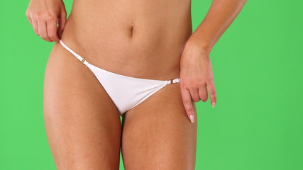 Woman's torso with black bikini underwear