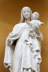 Madona and Child, portal of the church, Porto Azzurro, Italy