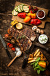 Wholesome spread with t-bone steak and veggies - 66523095