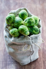 Fresh brussel sprouts on rustic background