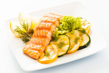 Salmon steak with zucchini and courgette